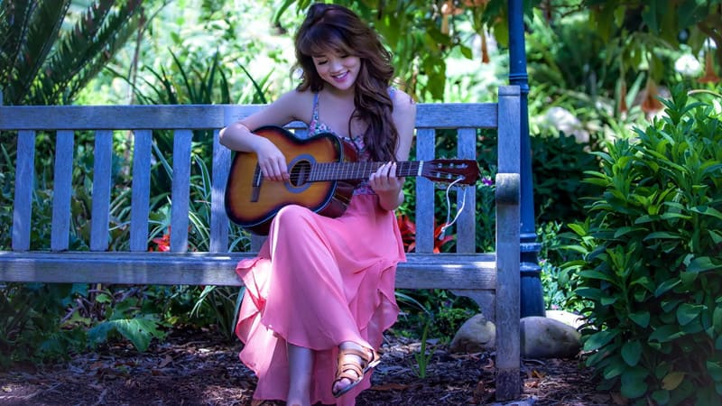 Asian women play guitar