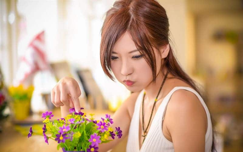 Asian women take care of flowers
